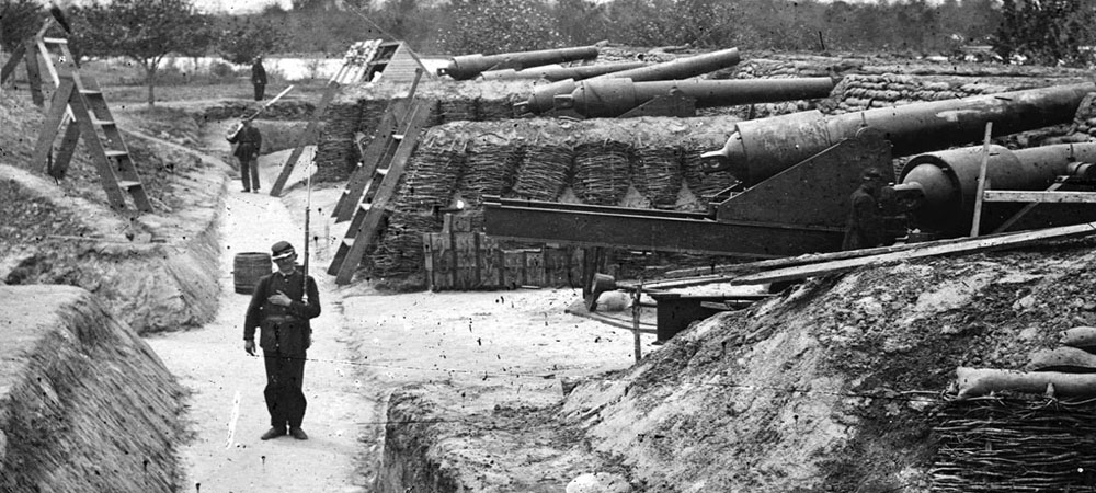 Soldier on duty in artillery trench